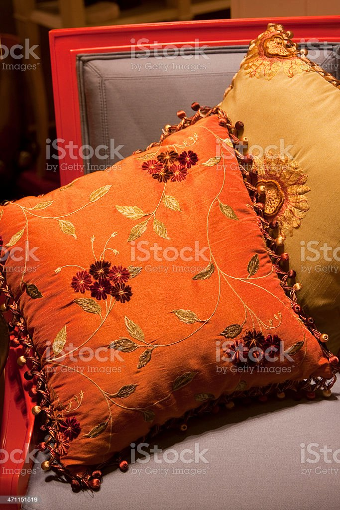 Decorative Pillows on Chair, Comfortable Luxurious Fringed Throw-Pillows royalty-free stock photo