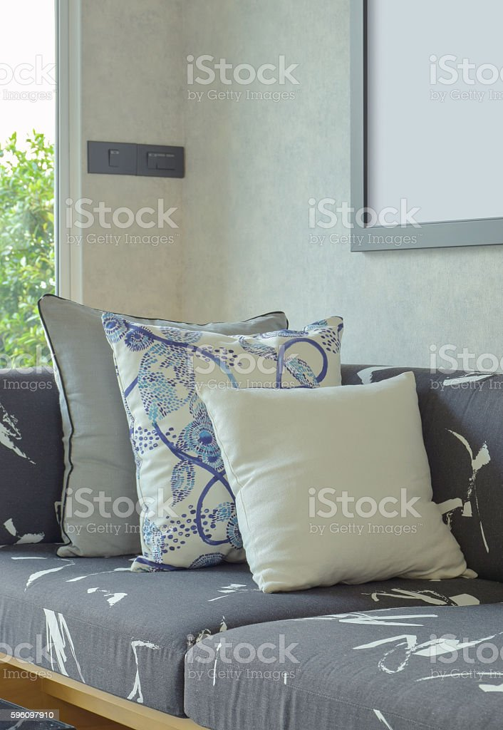 Decorative pillows setting on gray sofa in living room royalty-free stock photo