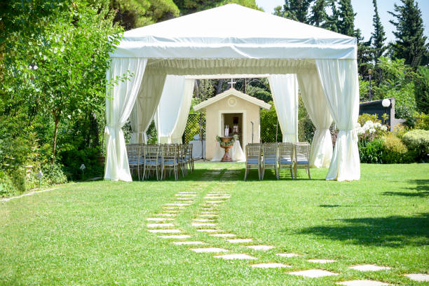 Decorative place for ceremonies or entertainments. Outdoor reception under tents and trees stock photo