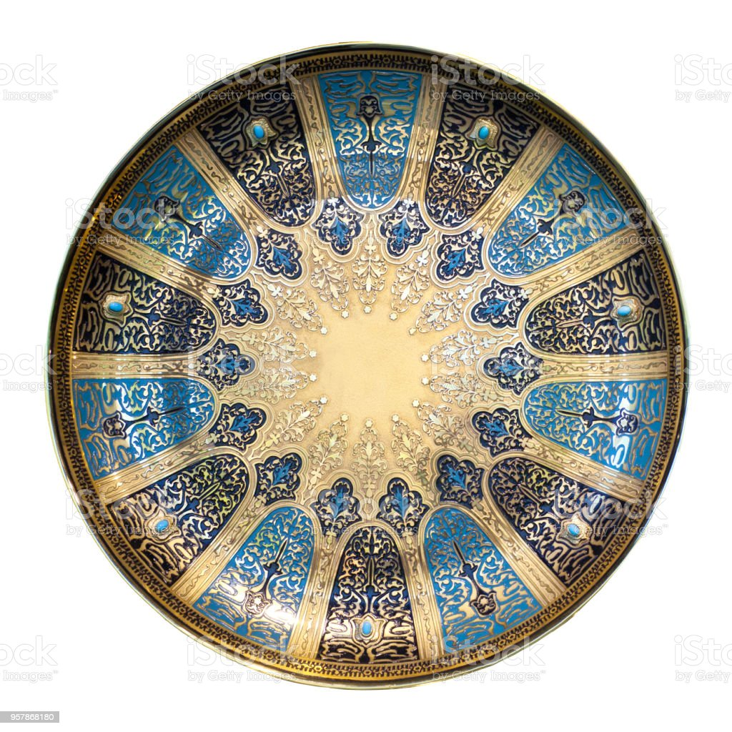 Decorative plate, oriental souvenir isolated on white background stock photo