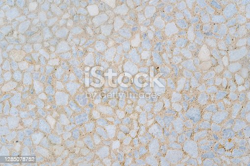 Decorative beige tile on the facade of the building as a background or backdrop. brick wall texture background. Brickwork or stonework flooring interior rock pattern clean grid of even bricks stack.
