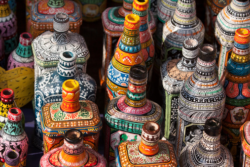 Decorative Pottery and bottles on display in shop for sale