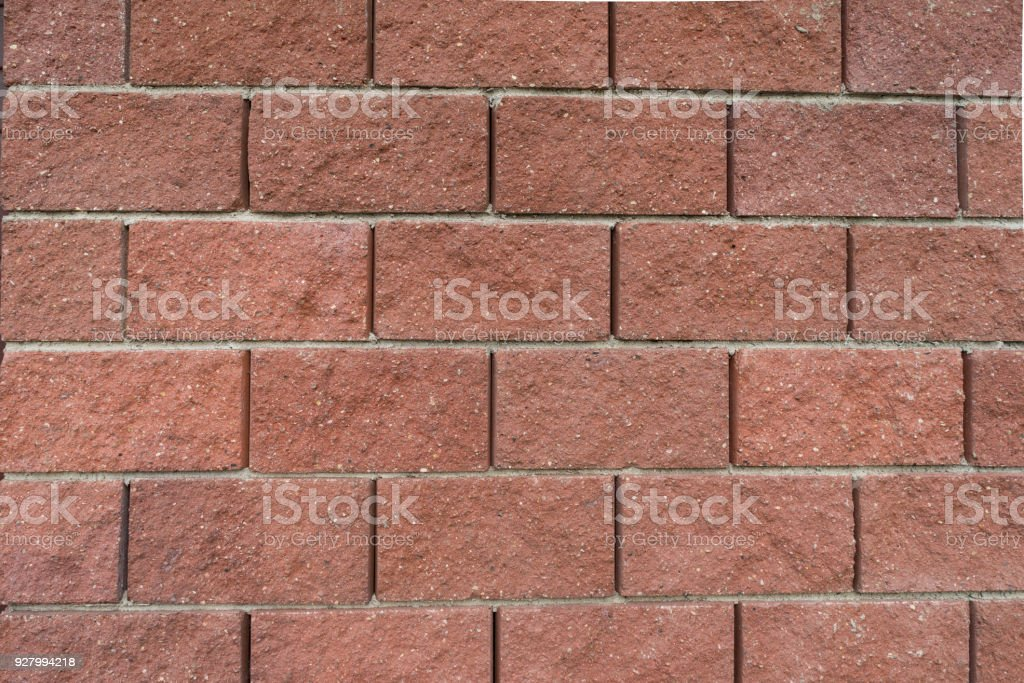 Decorative red stone wall stock photo