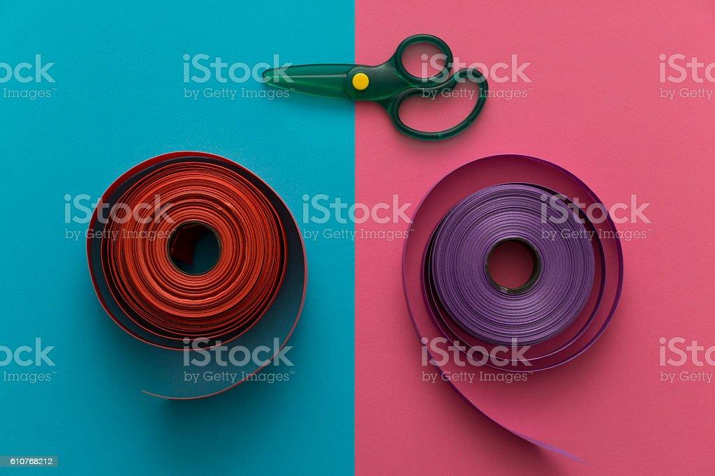 Decorative ribbons and scissors on rose quartz serenity blue background stock photo