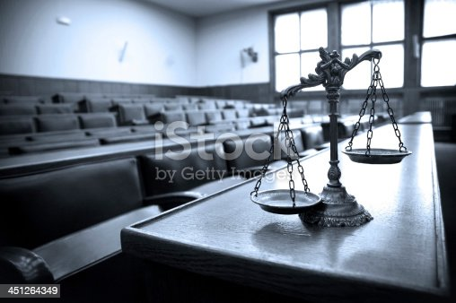 istock Decorative Scales of Justice in the Courtroom 451264349