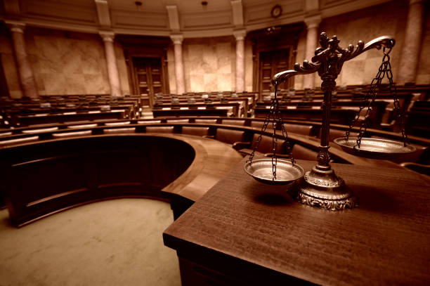 Decorative Scales of Justice in the Courtroom Symbol of law and justice in the empty courtroom, law and justice concept. courtroom stock pictures, royalty-free photos & images