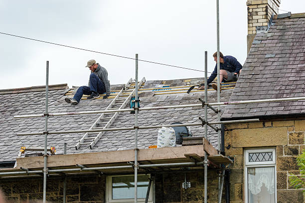 Decorative slate roof restoration in Wales. stock photo