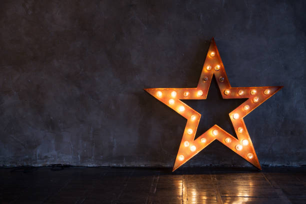 decorative star with lamps on a background of wall. modern grungy interior - stars imagens e fotografias de stock