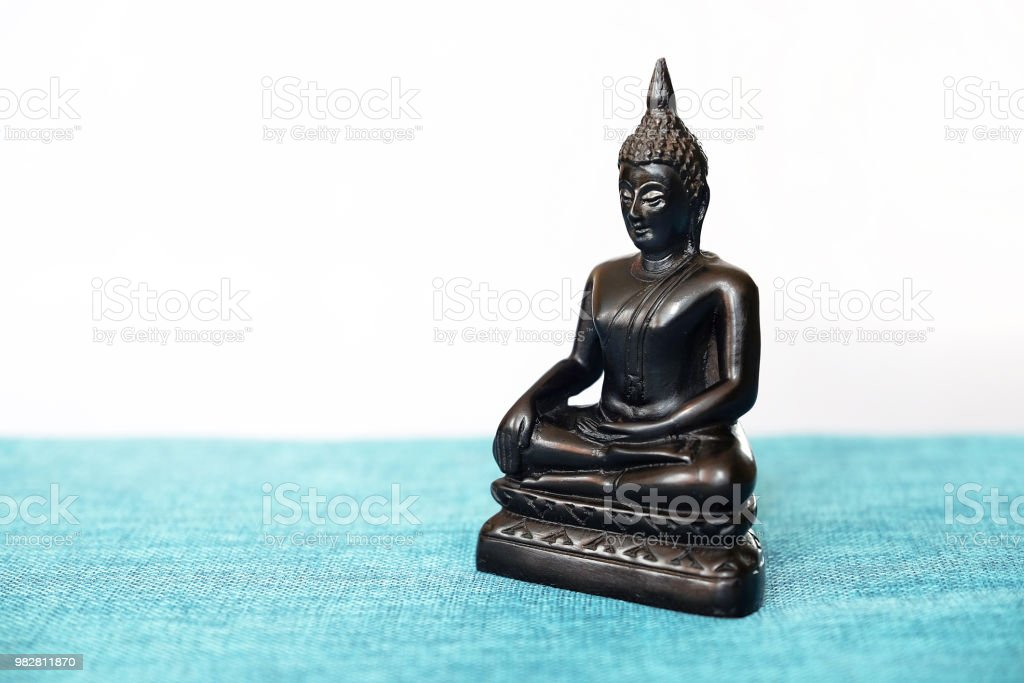 A Decorative Statue Of Buddha Buddha On The Background Of Incense