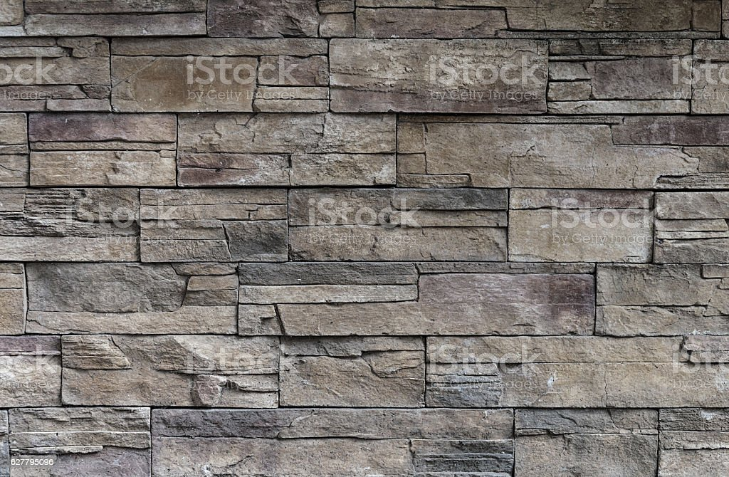 Decorative stone facing of wall stock photo