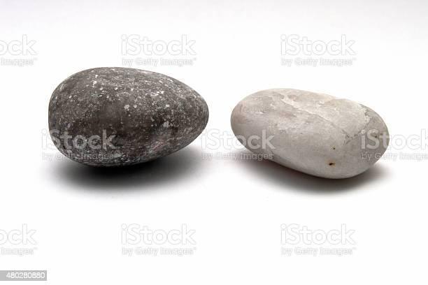 Photo of Decorative stone isolated on white studio background - macro