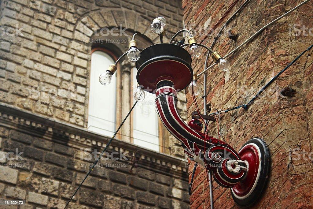 Decorative street lamp in Civetta (Little Owl) Contrada, Siena, Italy stock photo