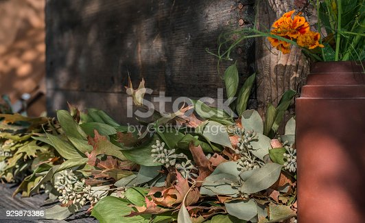 Floral Scene with Ceramic Vase and Wooden Bench