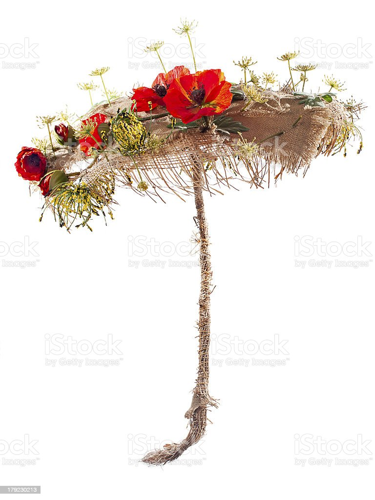 Decorative umbrella of burlap, mats and artificial flowers poppy. royalty-free stock photo