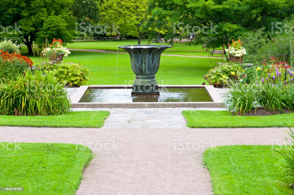 Decorative urn and pond in garden royalty-free stock photo