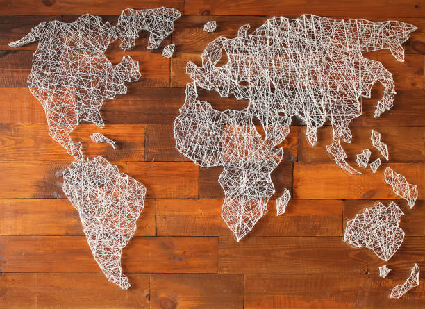 Decorative vintage map of the world made of threads and nails Decorative vintage map of the world made of threads and nails country geographic area stock pictures, royalty-free photos & images