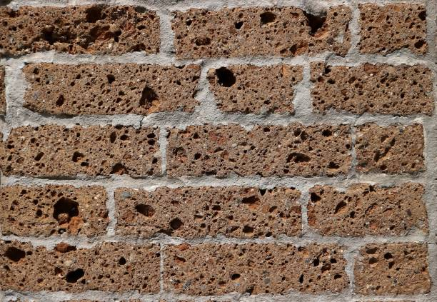 Decorative volcanic tuff bricks for exterior and interior wall . Close up. Decorative volcanic tuff bricks for  exterior and interior wall . Close up. Background and texture. tuff stock pictures, royalty-free photos & images