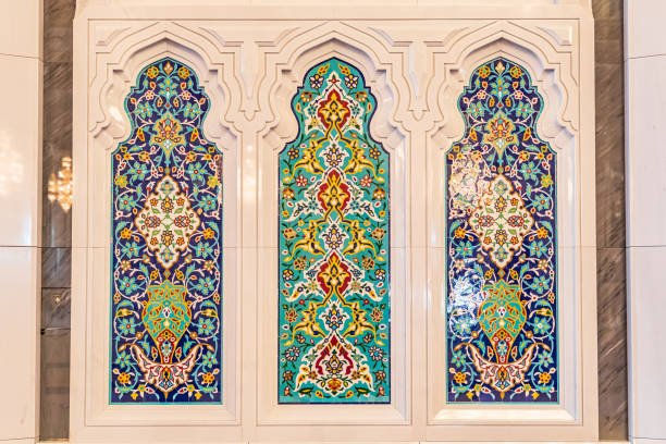 Decorative windows in the Sultan Qaboos Grand Mosque in Muscat. stock photo