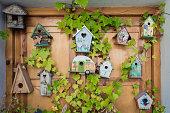 Decorative wooden made bird´s nest. with plants around it