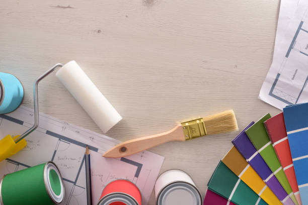 Decorator table with painting project and housing renovation background stock photo