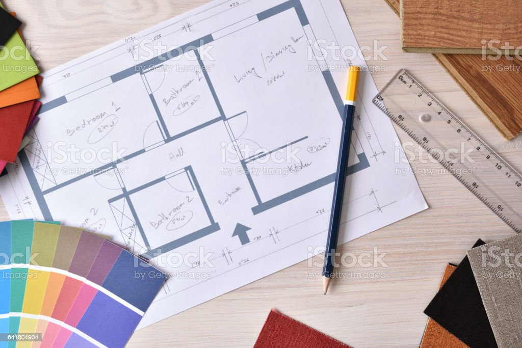 Decorator workbench with home plan on wooden table top stock photo