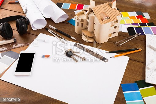 istock Decorator workplace with color swatches and tools 912037410