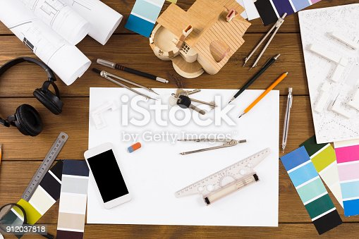 949860388istockphoto Decorator workplace with color swatches and tools 912037818