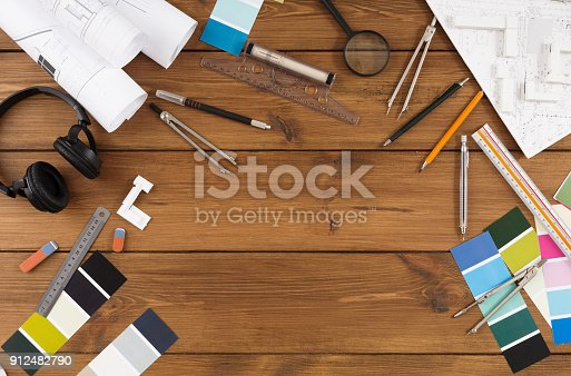 istock Decorator workplace with color swatches and tools 912482790