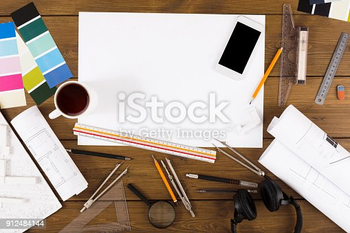 istock Decorator workplace with color swatches and tools 912484144