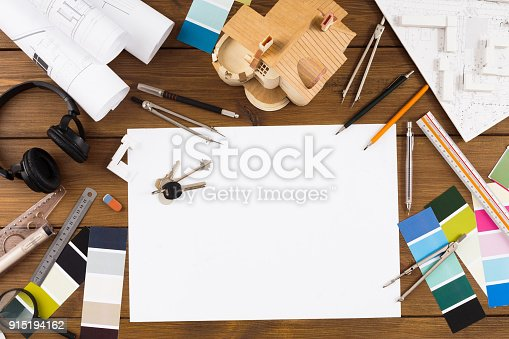 istock Decorator workplace with color swatches and tools 915194162