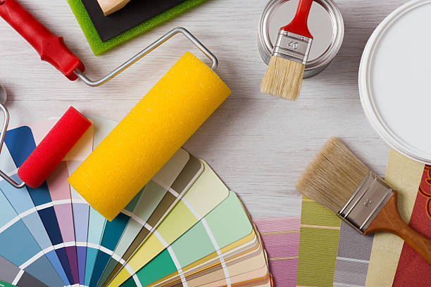 decorator's work table with tools - painter stock photos and pictures