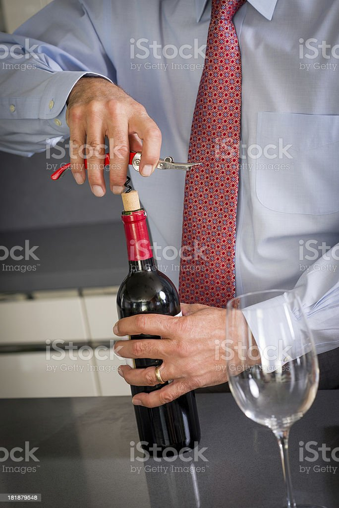 De-Corking A Wine Bottle royalty-free stock photo