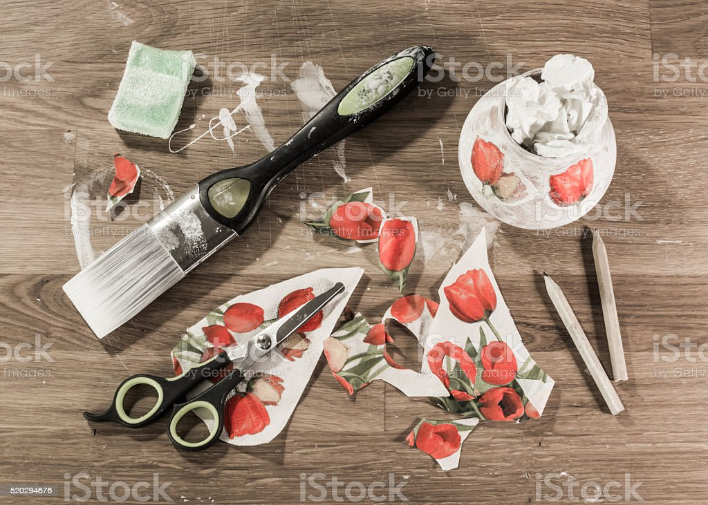 Decoupage tools on wooden table, stock photo