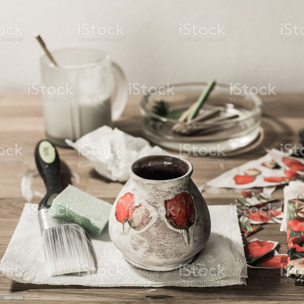 Decoupage tools on wooden table - square composition. stock photo