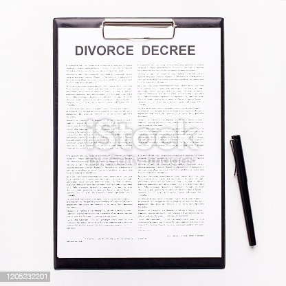 istock Decree of divorce, dissolution, canceling marriage on white 1205232201