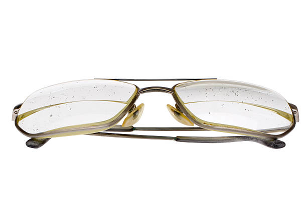 Decrepit eye glasses with thick bifocal lens in gold frame stock photo