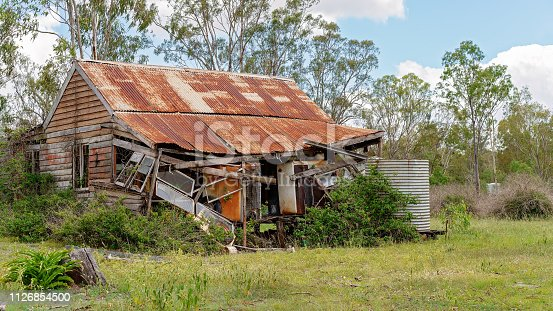 Old falling down hut about to cave in, seen in a country town in Australia