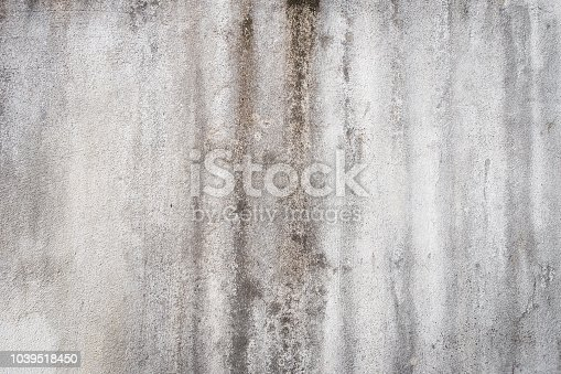 Decrepit White Dirty Plaster Wall With Cracked Structure Horizontal Empty Grunge Background. Old Gray Grey Mortar Wall With Rough Shabby Stucco Layer Isolated Texture. Blank Peeled Messy Surface