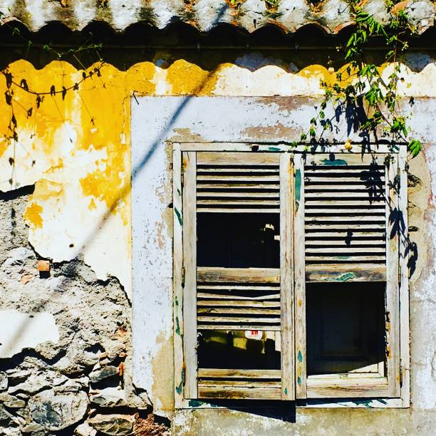 Decrepit yellow wall of funchal stock photo
