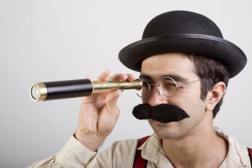 Dedective looking through old fashioned binocular