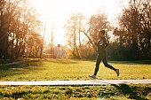 istock Dedicated African American female athlete running in the park. 1191764290