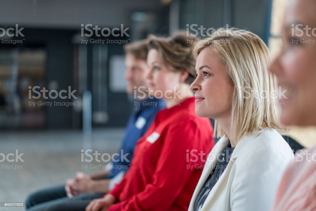 Dedicated business professionals attending seminar stock photo