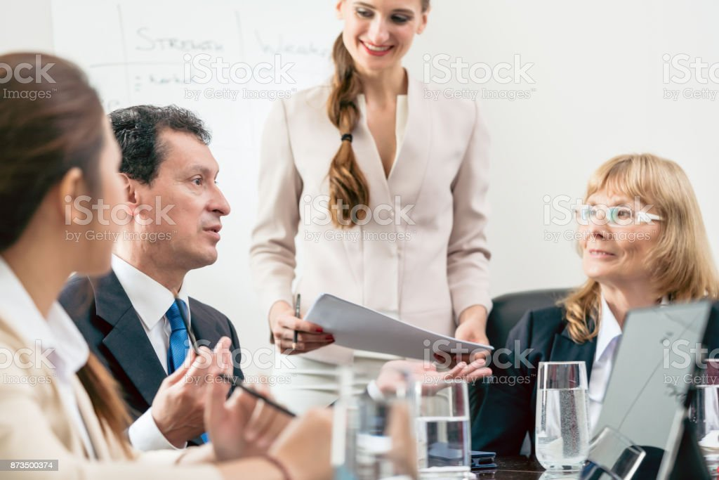 Dedicated manager sharing his opinion while interpreting a pie-chart during board of directors meeting stock photo