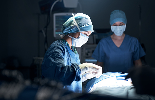Shot of surgeons performing surgery in an operating theatre
