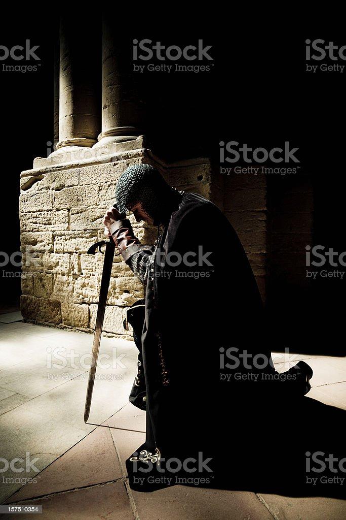 Dedication Knight Praying stock photo