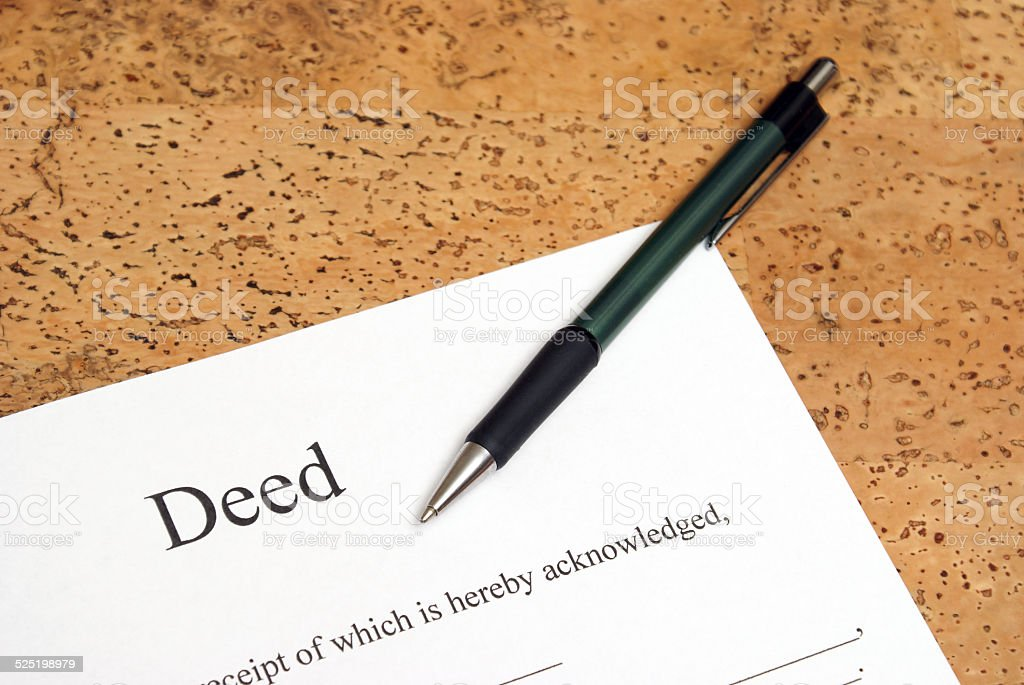 Deed stock photo