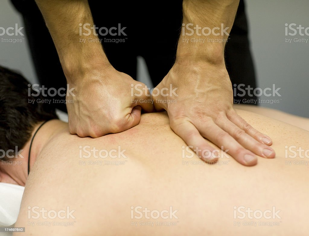 Deep Back Massage stock photo