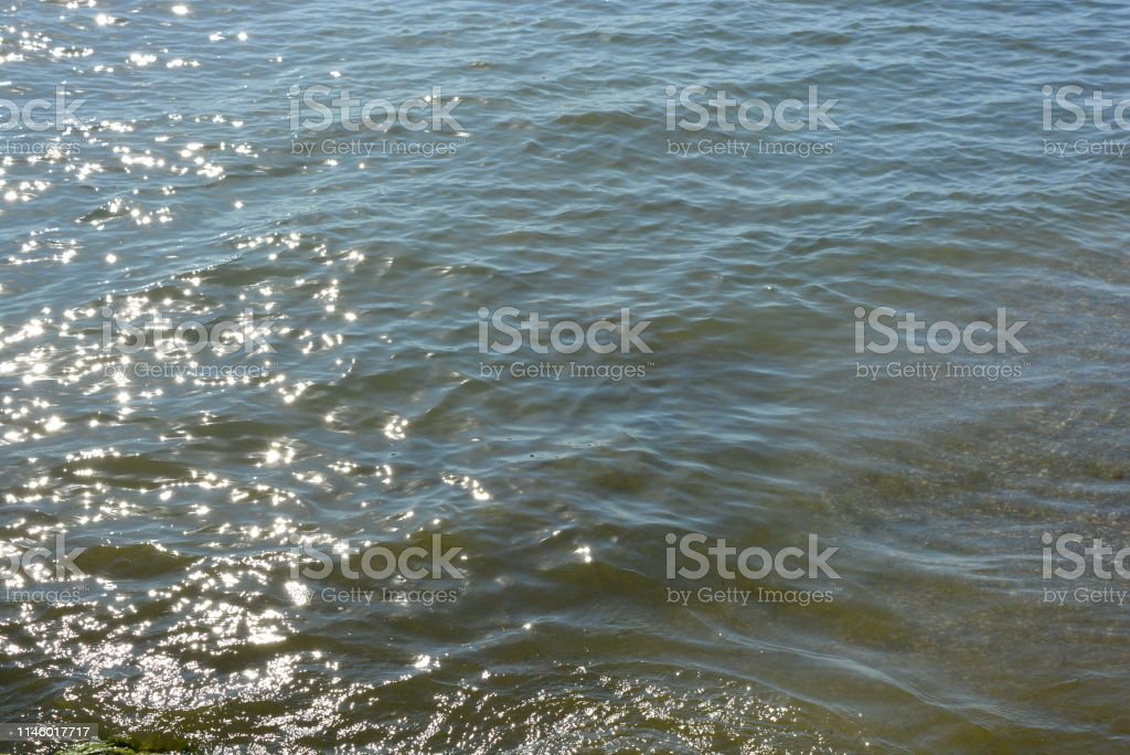 Deep Blue Black Seas With Small Waves And Small Golden And