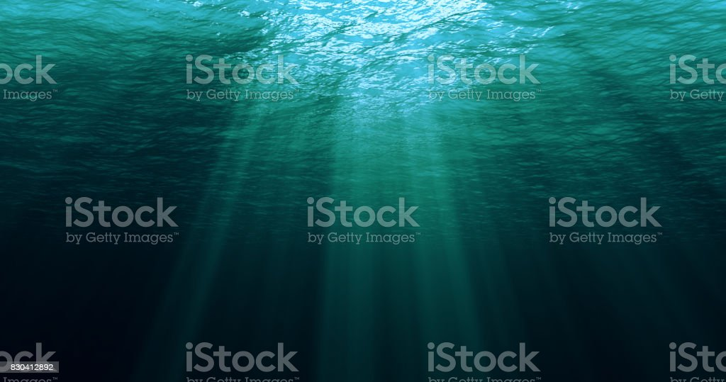 deep blue caribbean ocean waves from underwater background stock photo