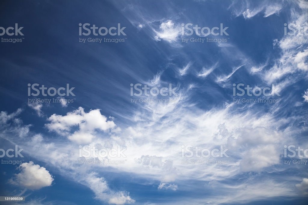 Deep Blue Sky With Slight Clouds royalty-free stock photo